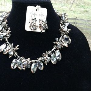 Sterling silver  necklace and earrings.